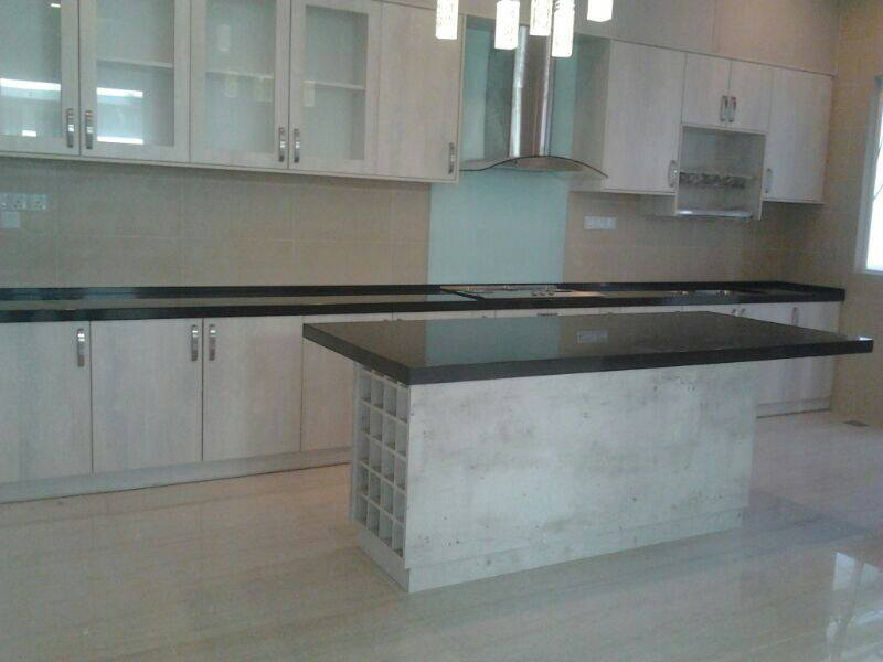 kitchen cabinet with black granite table top surface